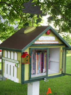 """Made this Little Free Library for my mom. She decorated it to the max and even held a """"Grand Opening"""" for the neighborhood."""