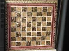 Khatam 2,is a Persian version of marquetry, art forms made by decorating the surface of wooden articles with delicate pieces of wood, bone and metal precisely-cut geometrical shapes. Khatam is also the capital of Khatam County in Iran. Khatam kari (Persian: خاتم‌کاری‎) is the art of crafting a Khatam. Common materials used in the construction of inlaid articles are gold, silver, brass, aluminum and twisted wire. Artworks with smaller inlaid pieces are generally more highly valued.