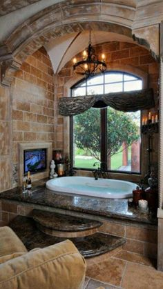 Dream Bathroom: perfect spot for tv.Just need a beautiful view out the window.