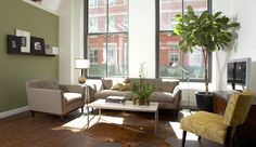 Furniture Stores in NYC: So Stylish and Fashionable!: Marvelous Furniture Store In NYC With Cool Brown Leather Carpet Cream Cool Sofa Also Green Sectional Sofa With Large Window Replacement Tv Cabinet And The Large Floor Vases As Indoor Planter As Hard Wood Flooring ~ surrealcoding.com bedroom Inspiration