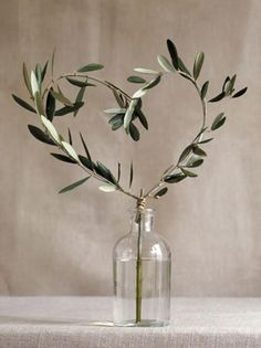 Olive leaf heart. Top table. Perhaps large wreath with small lights and hessian?