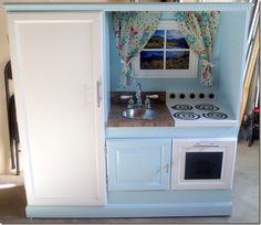 DIY Play Kitchen from an old entertainment center. My husband is so talented!