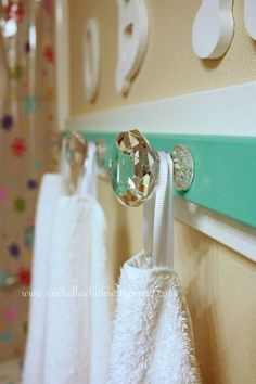 DIY Bathroom Towel Hooks We prefer towel hooks instead of bars for two reasons. For one, they make organizing towels so much easier, and secondly, you can use these gorgeous crystal knobs as hooks.