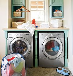 By adding a countertop and cabinets, this small nook becomes a fully-functioning laundry room. Even though the space is designed for utility, bright egg-shell paint and banister spindles bring in a bit of personality. LOVE IT!