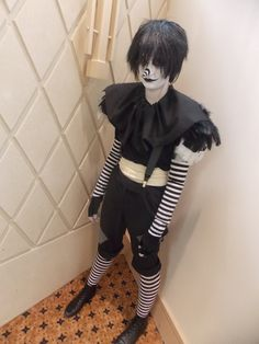 Laughing Jack Cosplay | Laughing Jack 2 by Pridefulmystery.  The angle of this picture is very clever.  Horizontal stripes mess with depth perception and the angle of the shot does just enough that it makes his arms look longer than they really are!