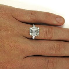 Harry Winston 4.01 Carat Emerald Cut Diamond Platinum Ring GIA | From a unique collection of vintage engagement rings at https://www.1stdibs.com/jewelry/rings/engagement-rings/