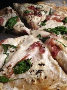 Satisfy your sweet and salty tooth with this bacon, goat cheese, spinach, and sorghum pizza... Think of your favorite drunk food that is actually enjoyable when sober.