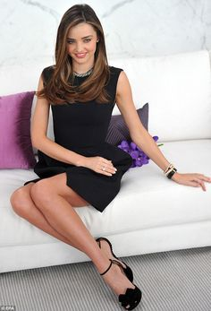 Slender star: She posed on a white sofa with purple accessories as it was revealed she is the new ambassador for the brand
