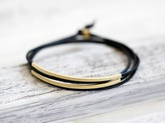 """18€ """"Tingval"""" is a handmade leather bracelet made of high-quality buffalo leather. This bracelet comes with two metal tubes and can be closed with a simple combination of a knot and a metal pearl. The..."""