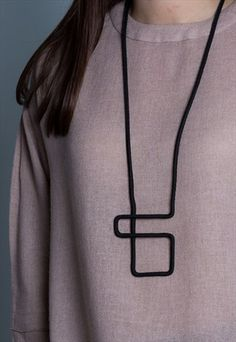 GRAPHIC COLLECTION LONG GEOMETRIC BLACK ROPE NECKLACE                                                                                                                                                     More