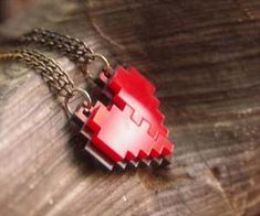 Give that special someone a heart necklace that they won't find cliche and cheesy with this pixelated heart necklace. Able to be broken in half - perhaps...