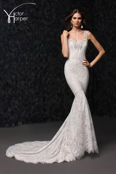 Multilayered lace fit and flare wedding gown with illusion strap and back yoke detail.   Sampled in Ivory/Nude Also in Ivory/Ivory