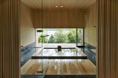 The Art of the Japanese Bath | Floating House between Sea and Forest  by Eiji Ueno / Oak Village.  Sliding glass doors slide open to reveal the corner of this home to the garden, and the bath can be used as rotenburo, traditional Japanese open-air bath.