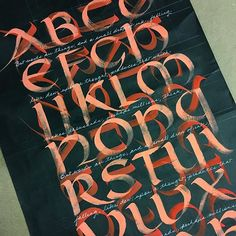 "#dailycalligraphy Day 6 of 7: Brush Uncial alphabet written in landscape followed by a second layer in portrait format with a 995 series @winsorandnewton brush from @paperandinkarts and white gouache mixed with vermillion ink on cheap black butcher paper from @aaronbrothersstores. Words by Lord Byron written in cursive with a @sakuraofamerica gel pen between the lines: ""But words are things, and a small drop of ink, falling like dew, upon a thought, produces that which makes thousands…"