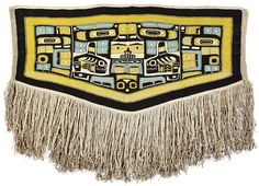 A Northwest Coast Chilkat blanket; With central design and mirror-image side panels, rendered in characteristic composite of body parts and complements, a pair of killer whales flanking a prominent face in the center. length 56in, width 73in