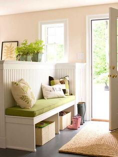 Build a low wall with seating bench for a cozy entry space where you can sit down and put on shoes before heading outdoors.