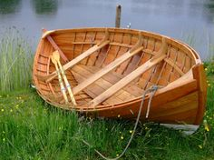 Double-ended rowing boat, like those used at the Aerie to get to the lake island.