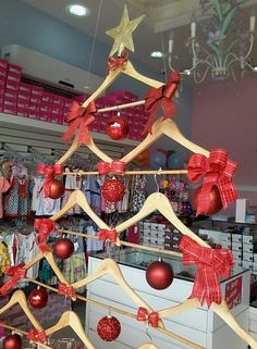 18 DIY Retail Display Ideas – How To Make Your Shop Look Great! – Expolore the best and the special ideas about Store window displays Diy Christmas Window Displays, Boutique Window Displays, Hanger Christmas Tree, Store Window Displays, Christmas Store, Christmas Decorations, Christmas Windows, Christmas Clothes, Xmas Tree