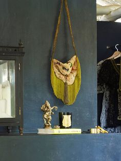 Bohemian Bedroom: A fringed purse and a statue of the Hindu deity Ganesha decorate a tropical bedroom in India.