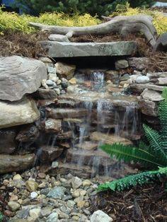 Backyard waterfall. A simple way of adding a small waterfall to the backyard.