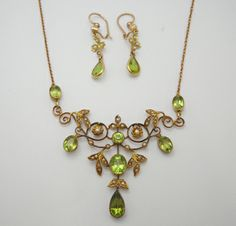Peridot & Pearls Necklace and Earrings Set Art Nouveau  12ct gold set peridot and pearl necklace with matching earrings.    Grays Antique Centre
