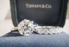 A must have.....Tiffany & Co - Round Brilliant Engagemnt Ring with 6 Claw Setting & A Half Alliance Ring