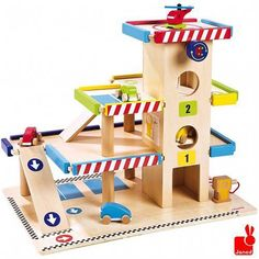 Janod Toy Garage Gas Station Wooden Playset, The Toy Centre Wooden Toy Garage, Wooden Car, Wooden Garages, Garage Accessories, Wooden Playset, Traditional Toys, Train Table, Christmas Catalogs, Wood Toys