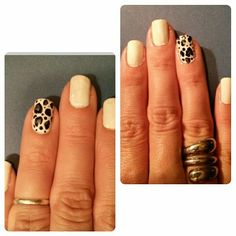 My digits. #nails White polish with silver & black leopard print.