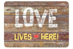 "Brown Home Accents Premium Comfort 22"" x 31"" Love Lives Here Mat by Ashley HomeStore"