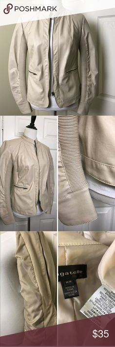 Bagatelle jacket Bagatelle tan Moto jacket. Zip front closure. Soft and comfortable, with side soft pleating. 2 front zip closure pockets. Mandarin collar. Bagatelle Jackets & Coats