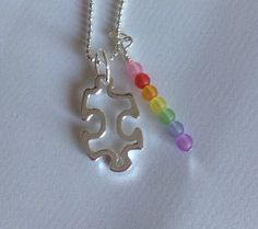 Autism Awareness necklace  proceeds go to TACA by ddbrown83