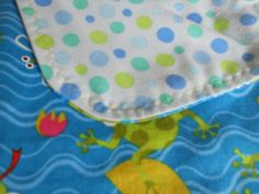 Baby blanket with frogs in water on one side and blue and green dots on the other side. by MissyCraftsandGoods on Etsy