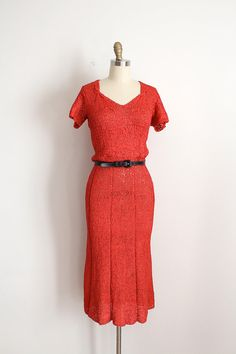 RARE 1930s ribbon crochet / knit dress. This dress features a lovely open neckline, short sleeves, and a slinky flattering silhouette.