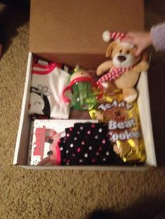 The night before Christmas box. Children open this on Christmas Eve night. It has a book, a Christmas movie, pjs, a new buddy to cuddle, a snack and a new cup (if toddler).