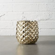 Shop colada pineapple vase-planter.   Studded with a gleaming diamond texture, this metallic vase abstracts the pineapple—a classic symbol of hospitality.
