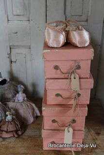 a pair of ballet slippers upon a stack of pink boxes :0)