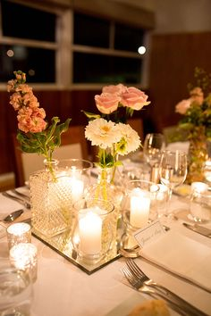 Auckland and north shore wedding flowers flowers for venues events reception centrepiece with crystal bud vases and candles liz jorquera see more httptheweddingplaybookintimate english garden style wedding junglespirit Image collections