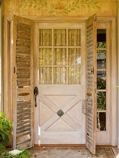 Vintage shutters add rustic style to this distressed entryway. See more ideas for front doors: http://www.bhg.com/home-improvement/door/exterior/exterior-door-ideas/?socsrc=bhgpin040413vintagedoor=5