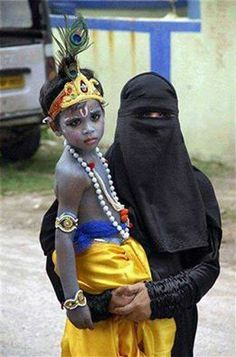 Unity in diversity.A Muslim woman holding her child dressed as a Hindu God Krishna.This happens only in India, beautiful message.