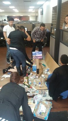 Staff from Intelicare Direct working hard to create awareness for our Earth Day project of the Pacific Garbage Patch.