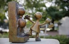 This is one of the small Tom Otterness sculptures that are part of his larger piece, Creation Myth, located in the Memorial Art Gallery's Centennial Sculpture Park on the corner of University Avenue and North Goodman Street.