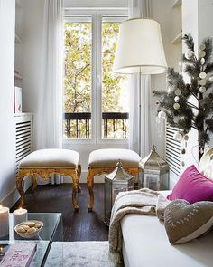 This is a fabulous little space. I would love to curl up with a book here. I LOVE those amazing stools too!