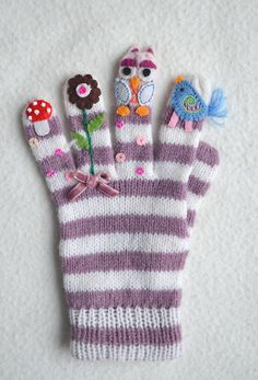 Transform a plain pair of gloves into something really sweet by stitching bits of wool felt to them.