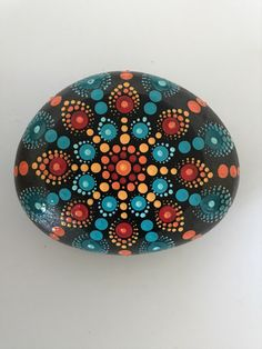 A personal favorite from my Etsy shop https://www.etsy.com/listing/494954968/mandala-stone-hand-painted-rock-dot