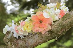 "This flower crown uses floral wire and artificial flowers. This adult flower crown's circumference is 22"" with an adjustable ribbon in the back to make it larger."