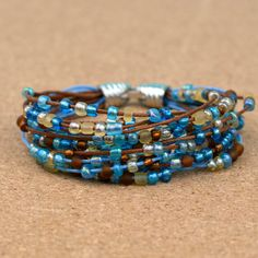 This boho-style beaded bracelet is as simple to make as cutting and using glue! There are no special tools or expensive components necessary, making this a great project for beginners. jewelry crafts How to Make an Easy Boho Beaded Bracelet Leather Jewelry, Wire Jewelry, Boho Jewelry, Jewelry Crafts, Beaded Jewelry, Jewelery, Jewelry Necklaces, Jewellery Box, Jewellery Shops