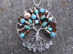 Blue and brown beaded Tree of Life suncatcher. Perfect for hanging in your kitchen window! Measures approximately 3 across