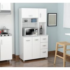 alcove™ microwave stand with pantry storage has an ideal spot for ...