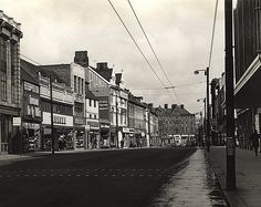 https://flic.kr/p/7dfXNv   014668:Northumberland Street  1965   Description : A view of the street looking towards the Haymarket. A number of shops are pictured on the left of the photo including Freeman  Hardy and Willis; Dolcis; Weston's and Tru-Form. the Tatler cinema is pictured at the top of the street.  Newcastle: Roads