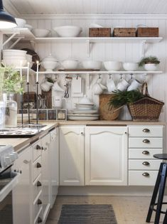 Elegant Open Shelves, White Cabinets, Wood Counters   A Farmhouse Delight